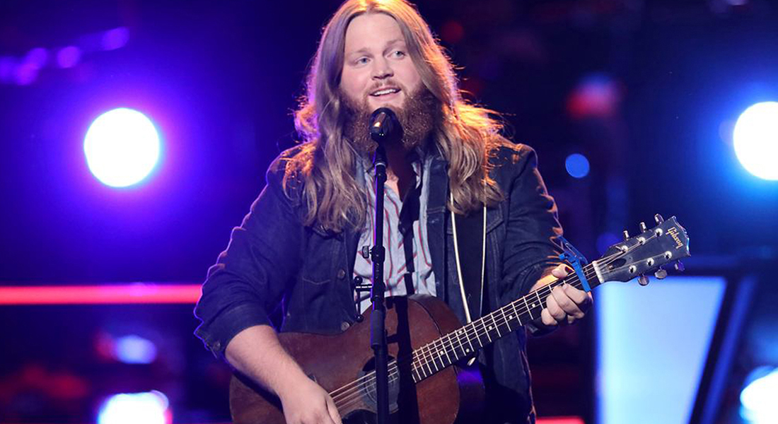 "Chris Koze, son of JENNIE-O team member Jeff Koze, dazzles the crowd on his guitar on the stage of hit TV show ""The Voice."""