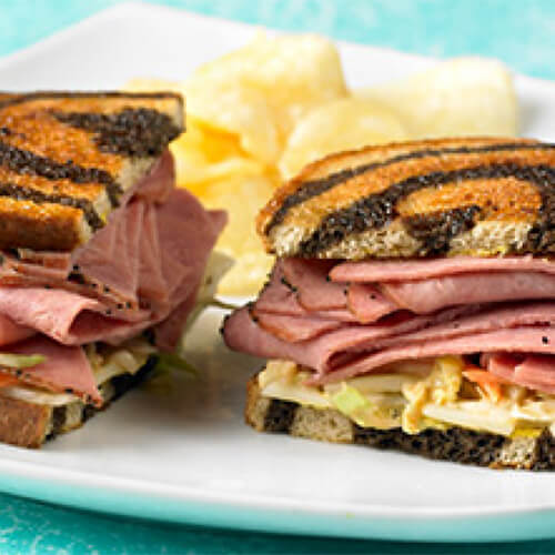 JENNIE-O® Turkey Pastrami, coleslaw, and melted Swiss cheese on marbled rye bread.