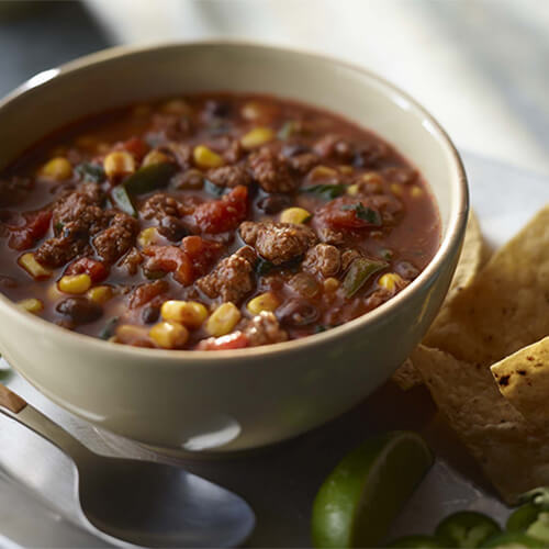 Delicious bowl of turkey enchilada chili made with corn and peppers.